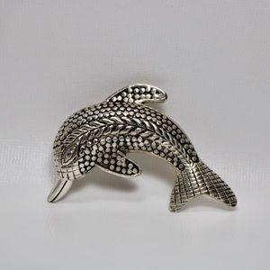 Silver tone dolphin brooch